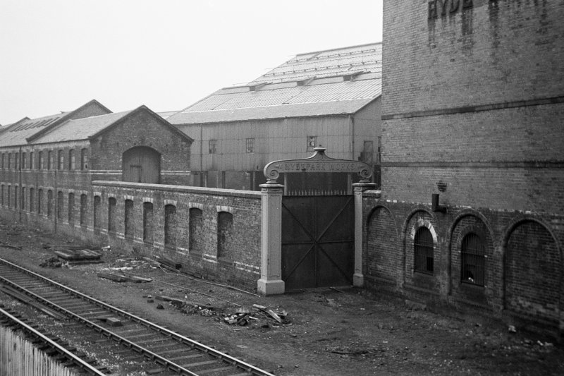 View from NW showing WNW front of N railway gate with works in background