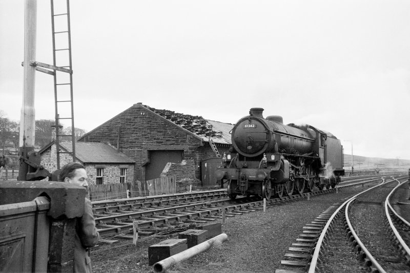 View from NE showing locomotive passing goods shed