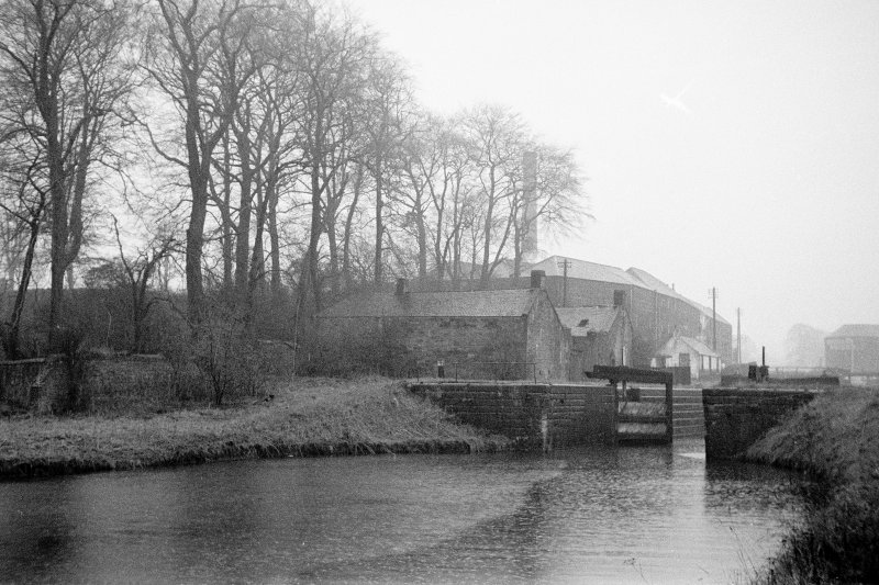 View from NE showing ENE front of lock with depot, cottage and distillery in background