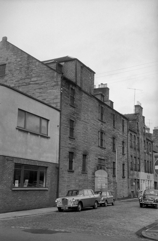 View from S showing ESE front of warehouse with numbers 17-21 Speygate in background