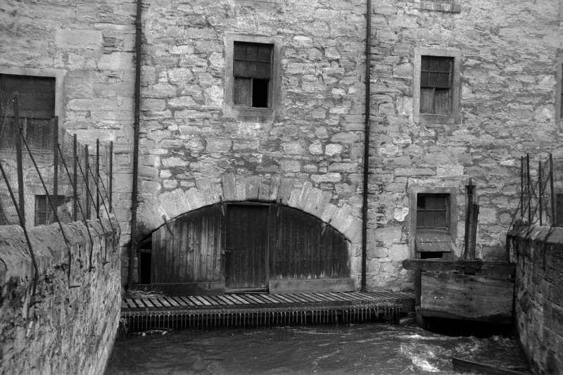 View from W showing sluice and WSW front of arch of wheelhouse of lower city mills