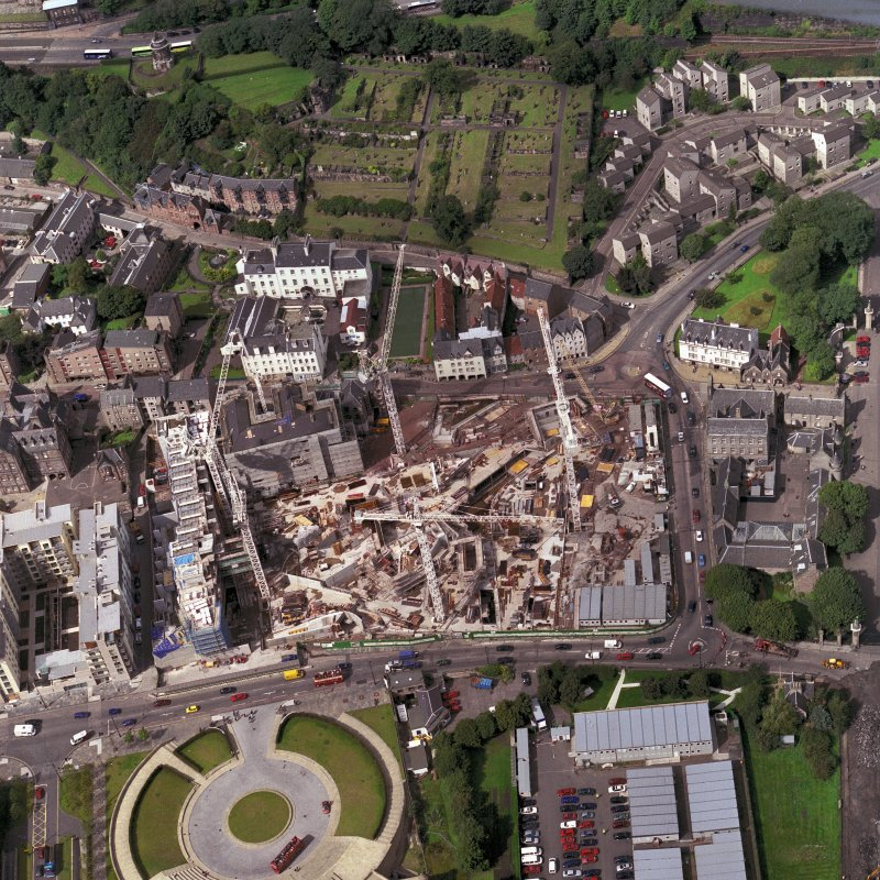 Oblique aerial view of Edinburgh centred on the Parliament site under construction, including Queensberry House and 'Our Dynamic Earth'.