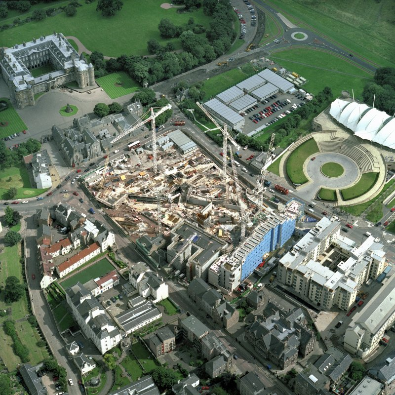 Oblique aerial view of Edinburgh centred on the Parliament site under construction, including Holyrood Palace, Queensberry House and 'Our Dynamic Earth'.