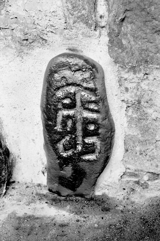 Small slab bearing incised cross. Original negative captioned: 'Cross at Churchyard of Dyce 1911'.