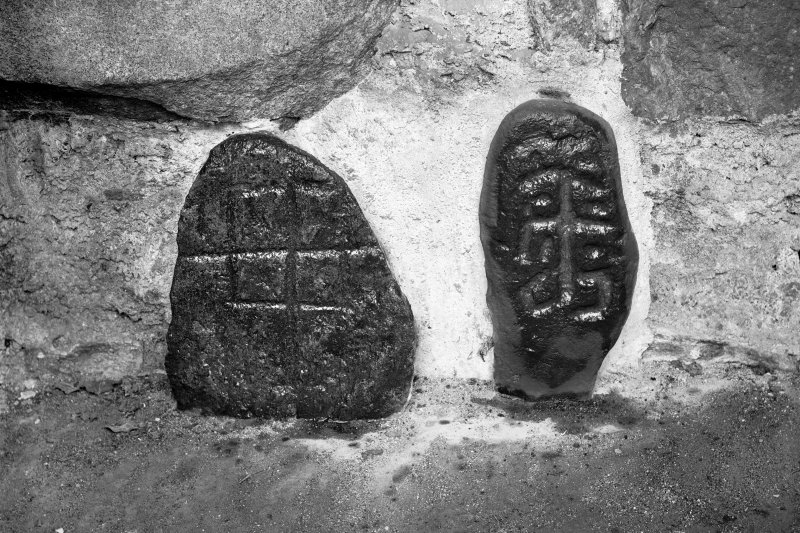 Two small slabs, bearing incised crosses.