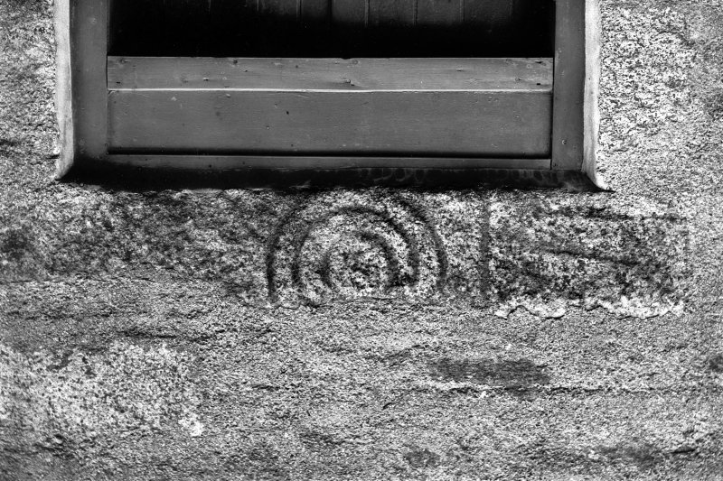 View of Pictish symbol stone reused as lintel.. Original negative captioned: 'Sculptured Stone above back-door at East Balhaggardy June 1914'.