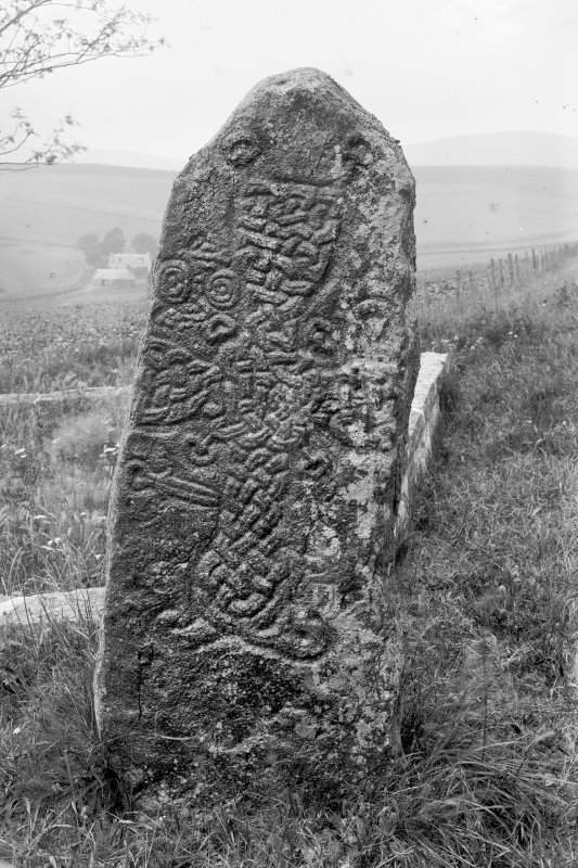 Pictish cross-slab. Original negative captioned: 'Sculptured Stone (Front) in Migvie Churchyard July 1904'.