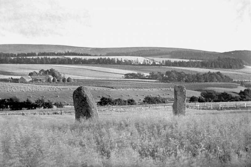 View of two standing stones. Original negative captioned 'Remains of Stone Circle at Mill of Noth, Rhynie. Sept 1905'.