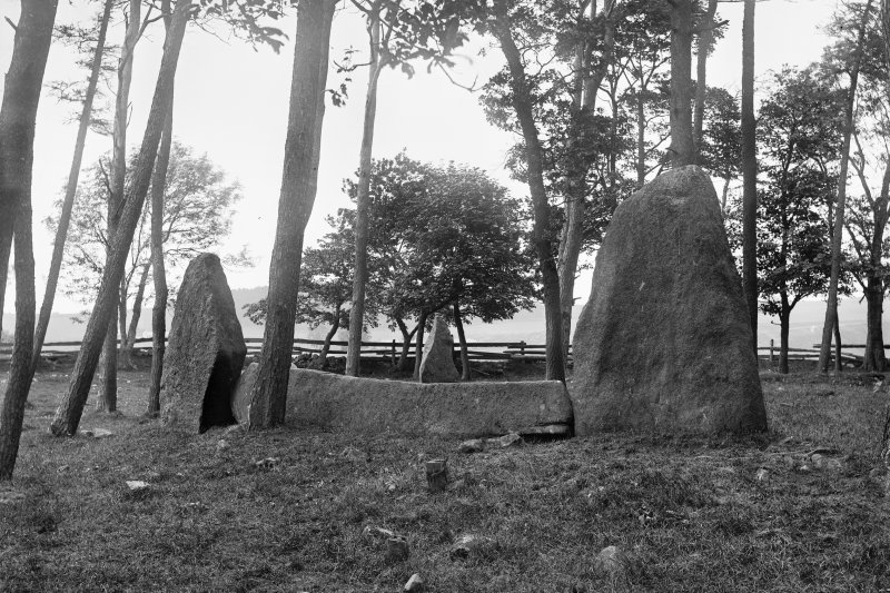View of recumbent stone and flankers. Negative captioned 'Sunhoney Circle near Echt. Recumbent Stone and Pillars viewed from outside circle looking North July 1902'.