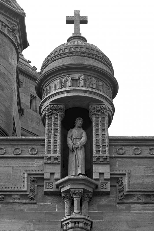 Detail of statue in niche on E facade.