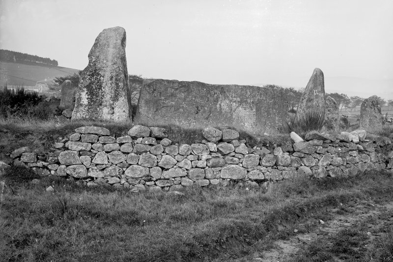View of recumbent stone and flankers, from the south west. Original glass negative captioned 'Auchquhorthies Stone Circle near Inverurie Rec. Stone from S.W. Nov. 1908'.
