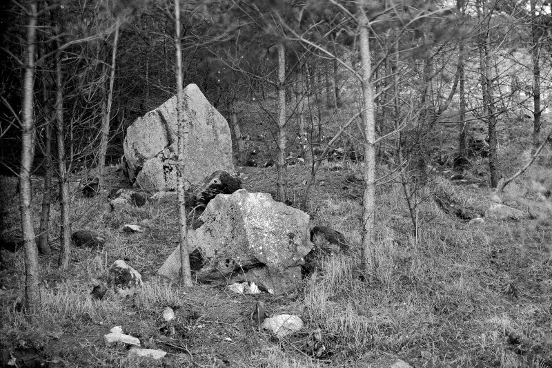 "General view showing stones and ditch. Print card captioned: ""Possibly a Class 1 Henge."" Original glass negative captioned 'Remains of Stone Circle at Hill of Tuack, Kintore April 1919'."