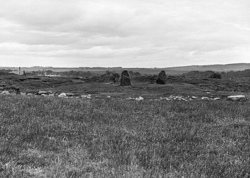 General view of stone circle, henge and Pictish symbol stone. Original negative captioned: 'Stone Circle near Broom Lodge Port Elphinstone June 1904'.