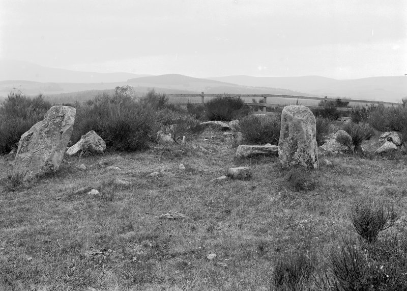 General view of stone circle from the east. Original negative captioned: 'Stone Circle on Tom-na-hivrigh (Tomnaverie) on farm of Mill of Wester Coull near Tarland July 1904. View from East side showing Stone Setting / Tom-na-hivrigh = Hill of worship or justice'.