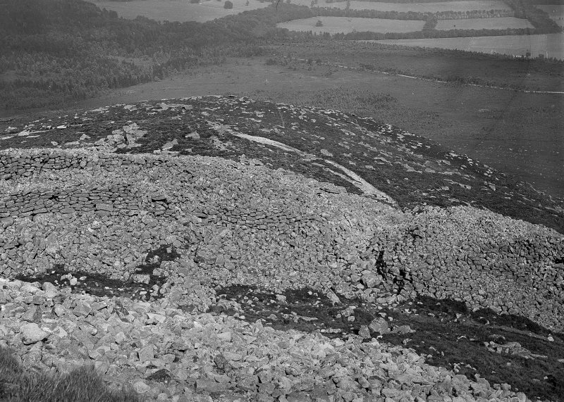 View looking down on interior of fort. Original negative captioned: 'Bennachie Hill-Fort. View fom top of inner rampart / Aug 1904'.