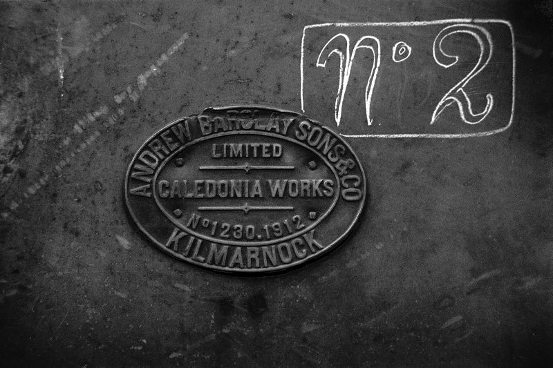 View showing makers plate for colliery locomotive which is inscribed 'ANDREW BARCLAY SONS & CO KILMARNOCK. CALEDONIA WORKS. LIMITED No. 1230. 1912'