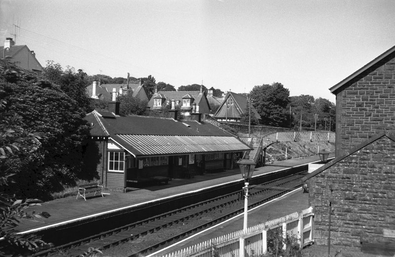 View from SW showing WSW and SSE fronts of up platform building with part of footbridge in background