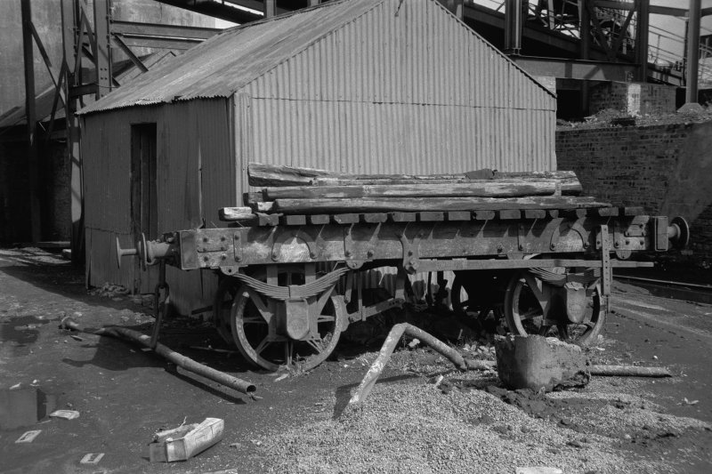 View showing old wagon with hut in background
