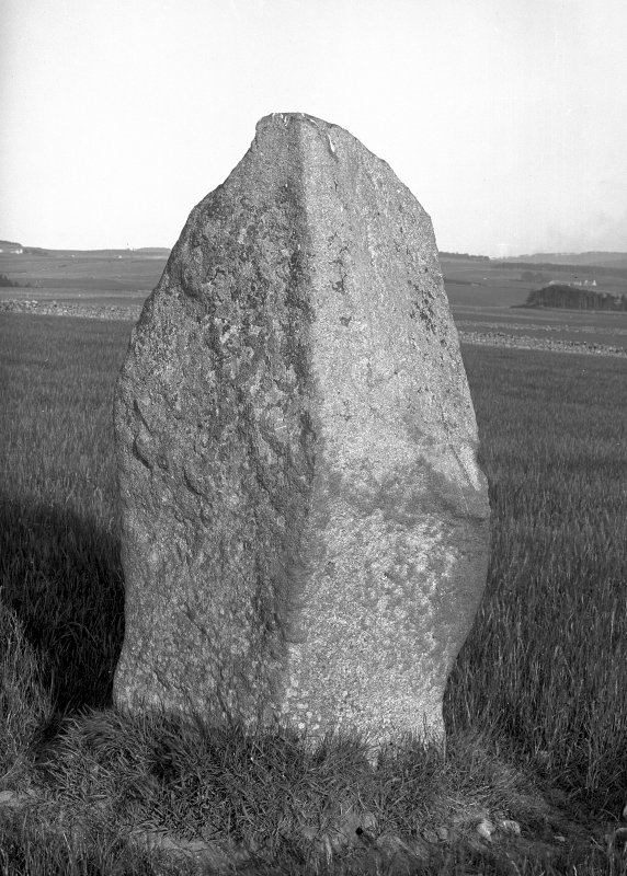 View of standing stone. Original negative captioned: 'Urn found near this stone (see Ordinance Survey 6 inch map) / Standing stone, sole remains of Circle, at Peathill, June 1904'.