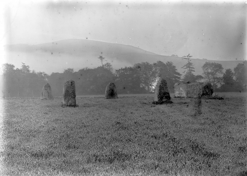 General view of the circle. Original negative captioned 'Rothiemay Stone Circle from the north'. Print card captioned 'West side, in early morning, shortly before sunrise, with rising mists.'