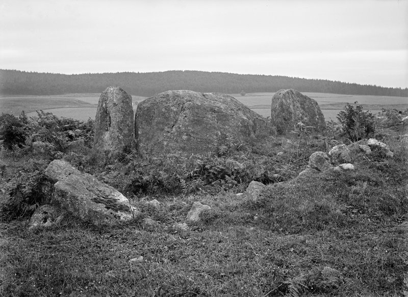 View of recumbent stone and flankers. Original negative captioned: 'Recumbent Stone and Pillars of Greater Circle at Eslie, Durris / View from outside of circle 1907'.