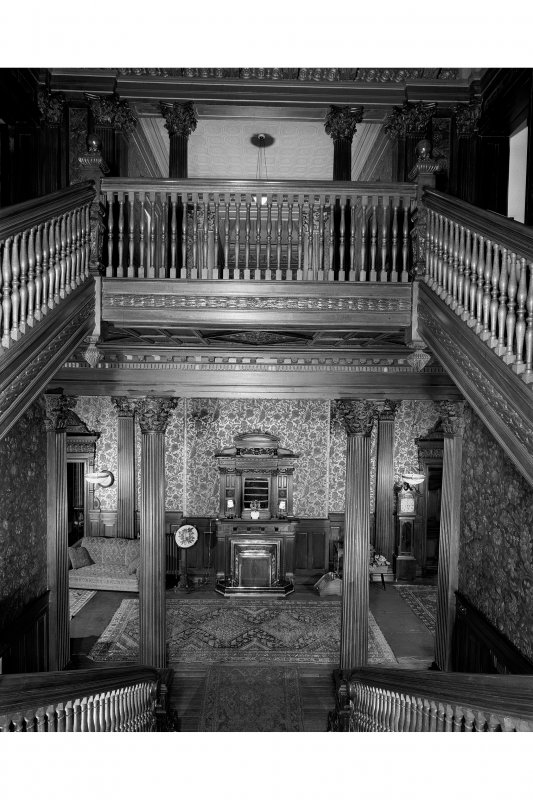 Interior. General view from staircase landing down to main hall.
