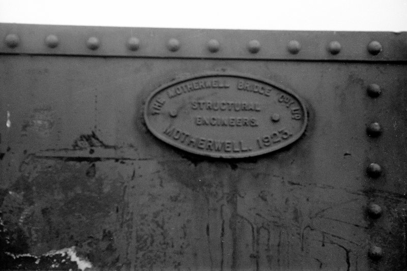 View showing plate on railway overbridge which is inscribed 'THE MOTHERWELL BRIDGE COY. LTD. STRUCTURAL ENGINEERS. MOTHERWELL. 1923.'