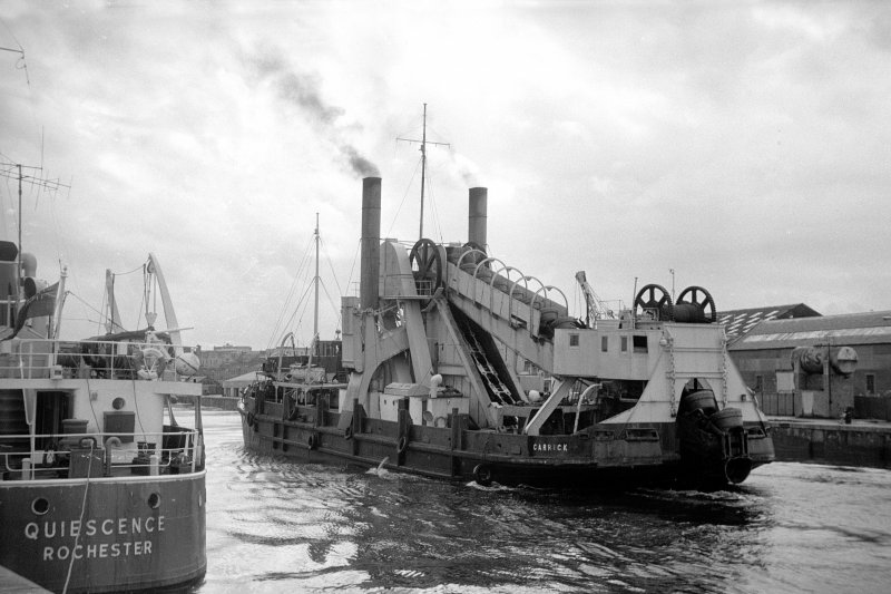 View from N showing dredger returning from dumping spoil