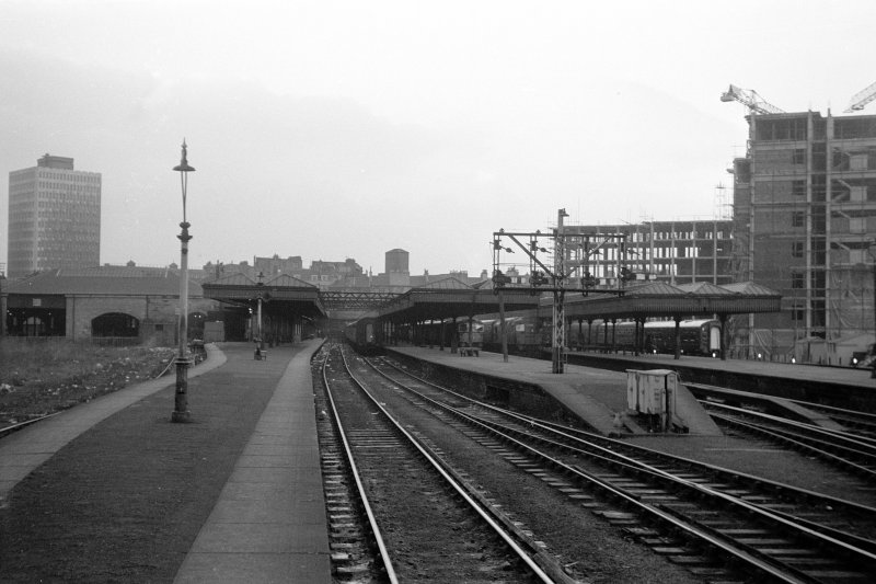 View looking SW from platform end showing passenger station with Buchanan House under construction in background