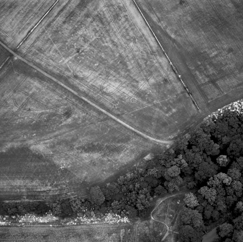 Inveresk: oblique air photograph of Roman temporary camps, enclosure, ring-ditches and long cist burials