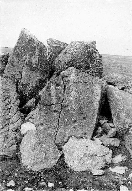 Detail of remnants of stone circle, showing cup-marked stone.
