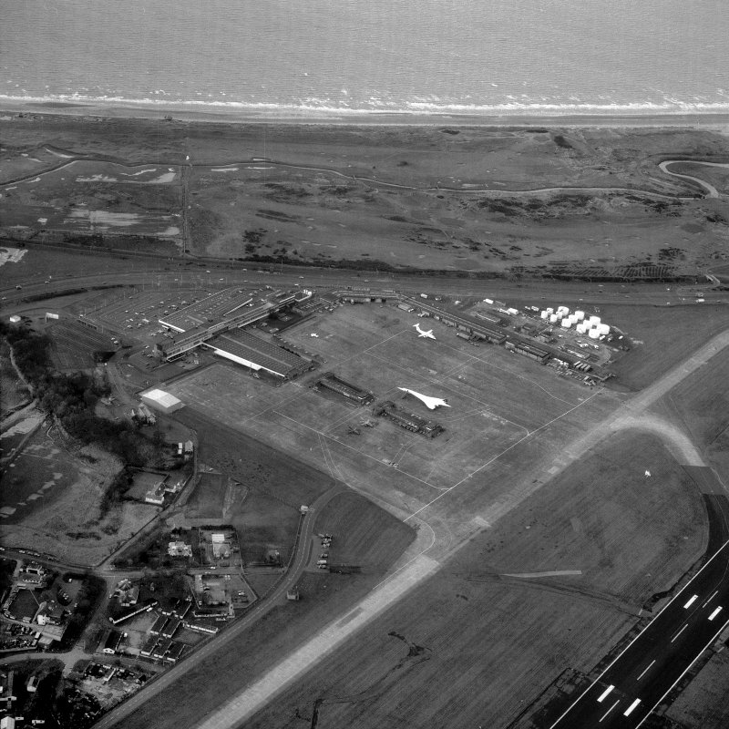 Scanned image of oblique aerial view showing part of the airport with Concorde on the apron.