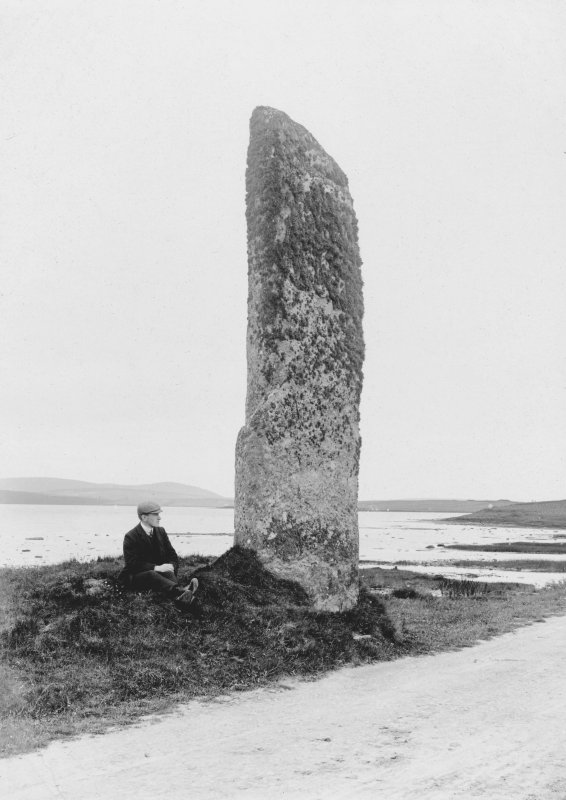 View of the Watch Stone. A seated figure serves as scale.