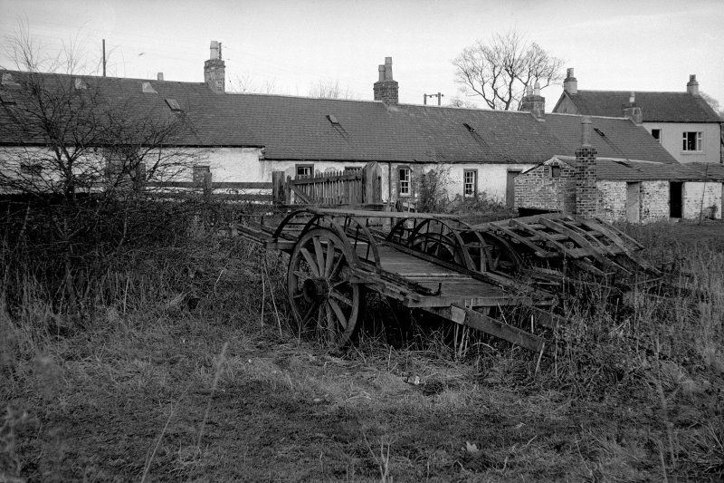 View from S showing farm carts with E cottages in background