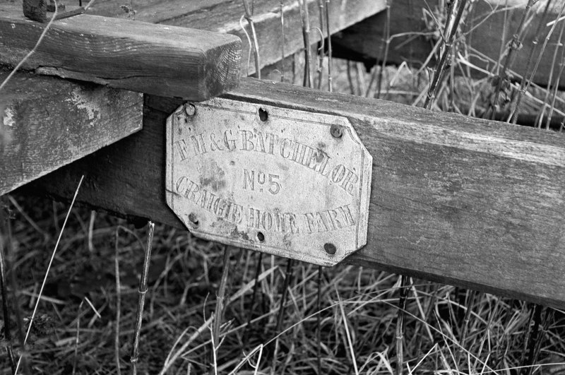View showing name plate on handle of farm cart which is inscribes 'F M & G BATCHELOR No. 5 CRAIGIE HOME FARM'