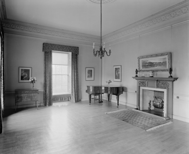 Interior-general view of empty room with piano and fireplace