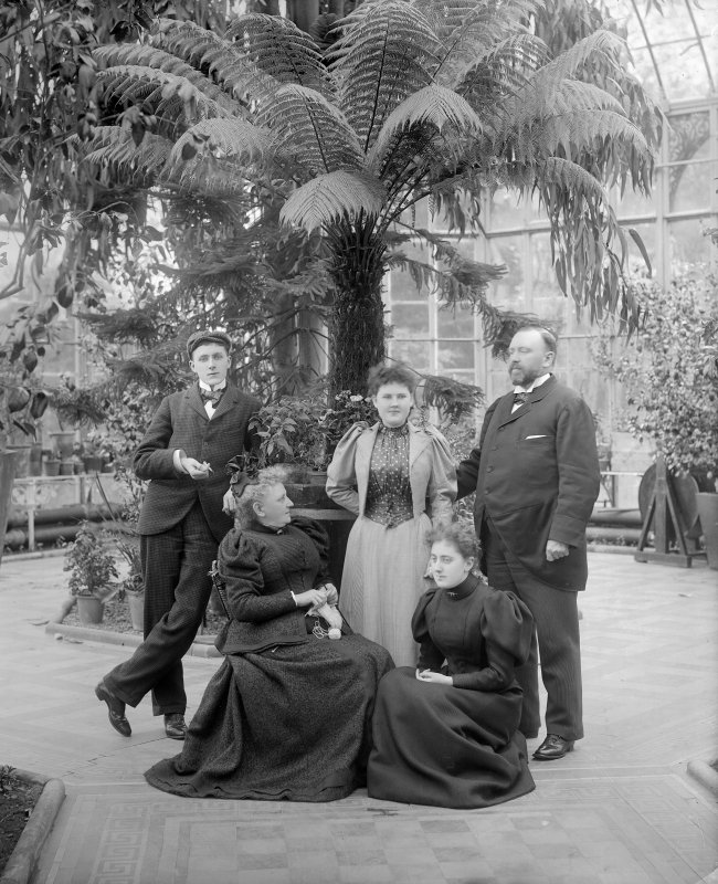 View of the conservatory, Peebles Hydropathic Hotel, with a group of people, possibly the hotel manager Albert Max Thiem and family.