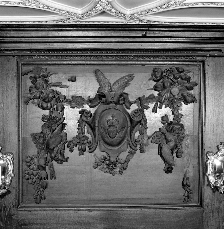 Interior, principal floor, dining-room, detail of carved wooden panel above fireplace.