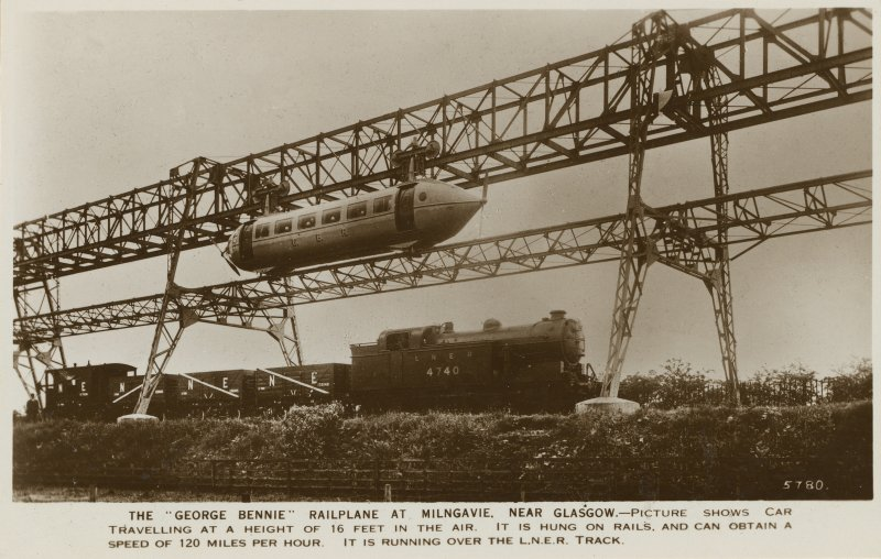 "Sepia postcard insc: 'The ""George Bennie"" railplane at Milngavie, near Glasgow - picture shows car travelling at a height of 16 feet in the air. It is hung on rails, and can obtain a speed of 120 miles per hour. It is running over the L.N.E.R. track.'"