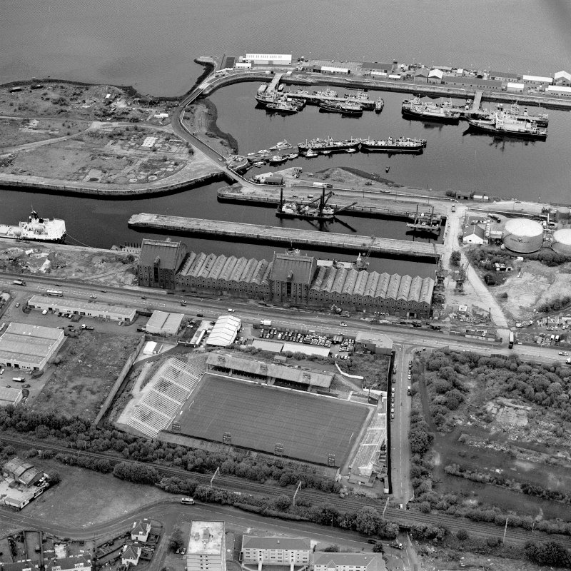 Greenock, James Watt Dock, oblique aerial view, taken from the SSW. Cappielow is visible in the foreground.