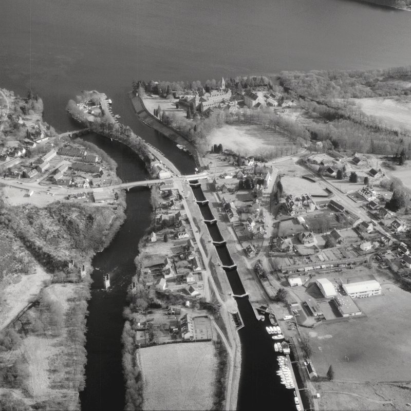 Scanned image of photograph showing oblique aerial view of Fort Augustus Locks, village and abbey