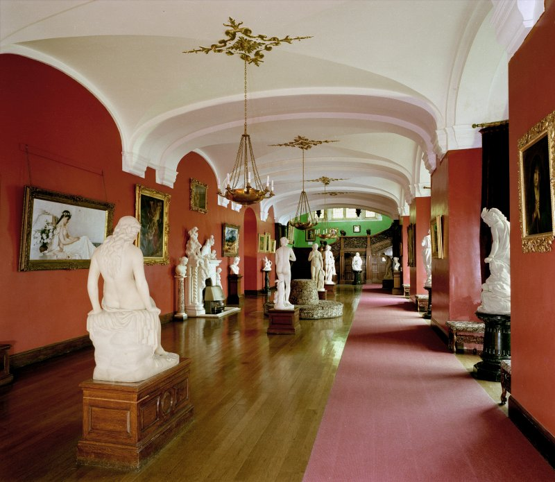 View of sculptures in stone hall, ground floor of Carbisdale Castle, Highland, taken from East North East.