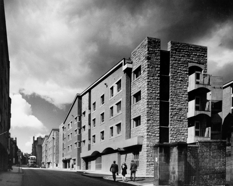 Photographic view of housing showing Canongate facades. Scanned image of B 78671.