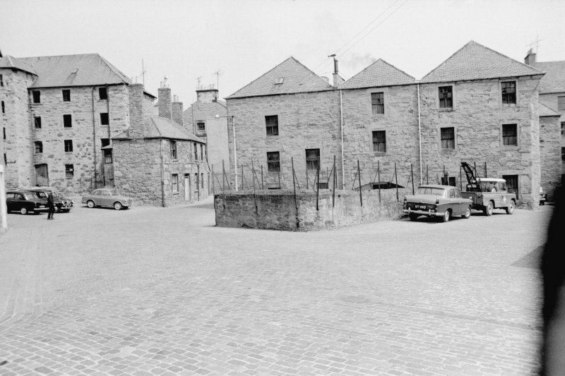 View from WSW showing WSW front of lower city mills with town's lade in foreground and granary and numbers 60-59 in background