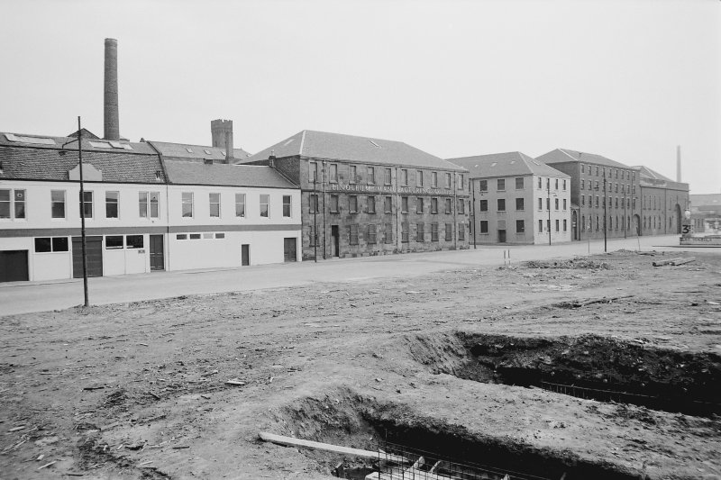 View from N showing WNW front of paint mill with dyeworks and paint factory in foreground and engine works in background