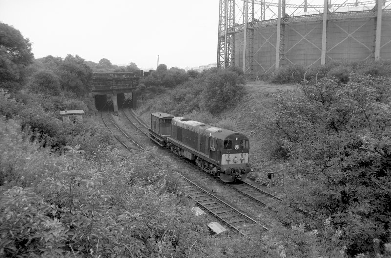 View looking W showing English Electric Type 1 Diesel with bridge on left and part of gasholder on right