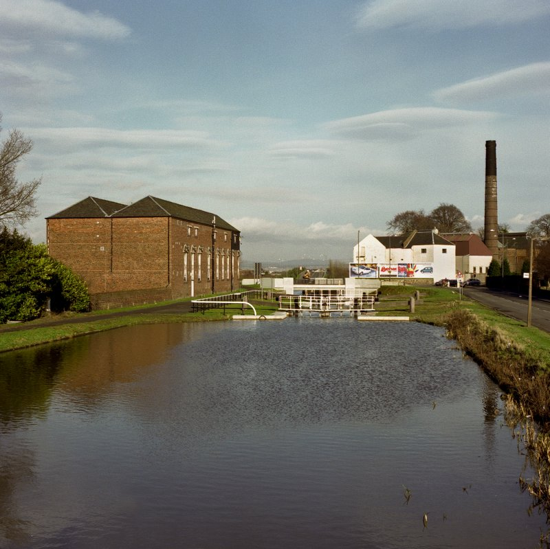View of distillery and warehouses from canal bridge to south west