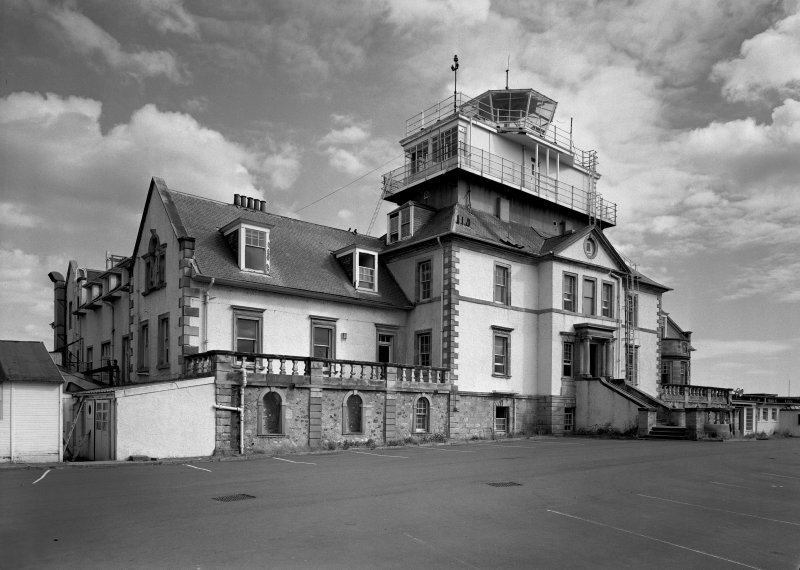 View of front facade of house with control tower.