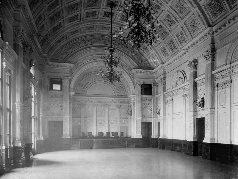 Interior-general view of meeting room showing marble walls with stage at far end