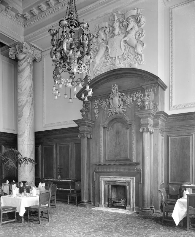 Central Station, Glasgow. Detail of ornate fireplace in Dining Room, including marble corinthian column and elaborate light fitting.